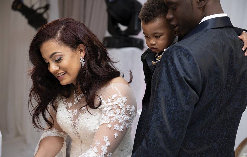 Chris, holding son CJ, and Mariana at their wedding in February 2019