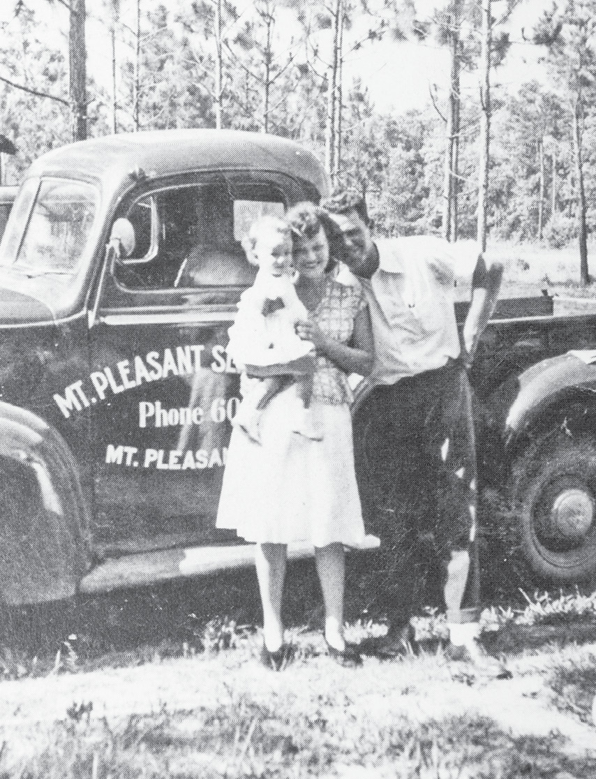 Captain Walter Toler of Mount Pleasant Seafood poses with his wife, Lillian, and daughter, Peggy.