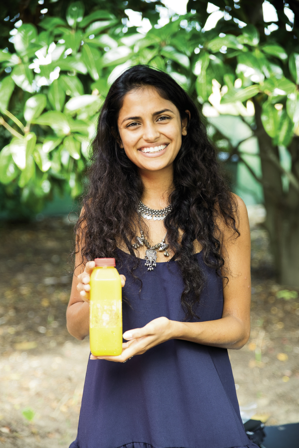 Ruchi Mistry of Huriyali Juices shows off a bottle of her company's cold-pressed juice made daily