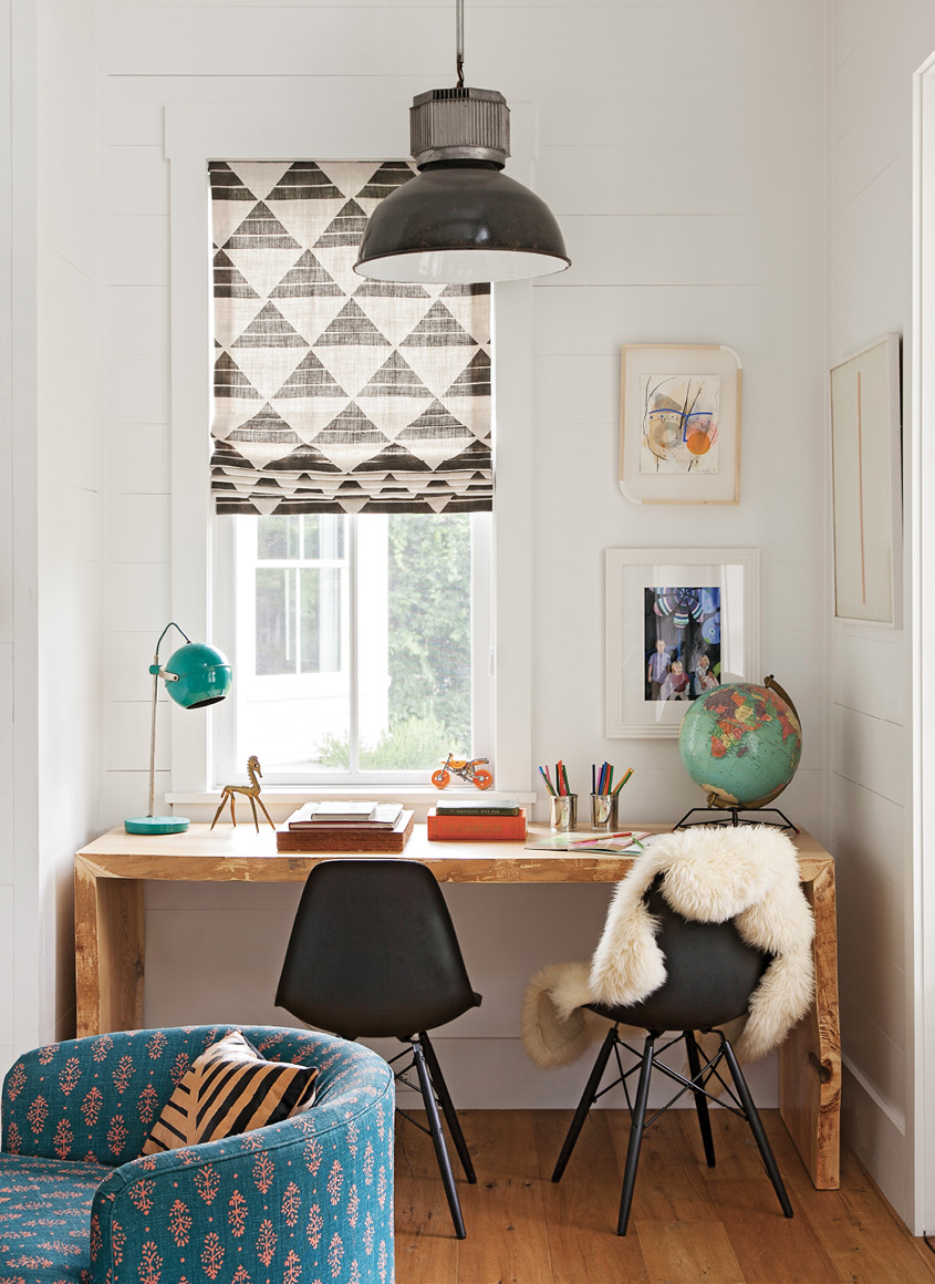 A small nook in the far corner holds a Hostetler Custom Cabinetry crafted desk and two Design Within Reach chairs for schoolwork, illuminated by a South of Market pendant light