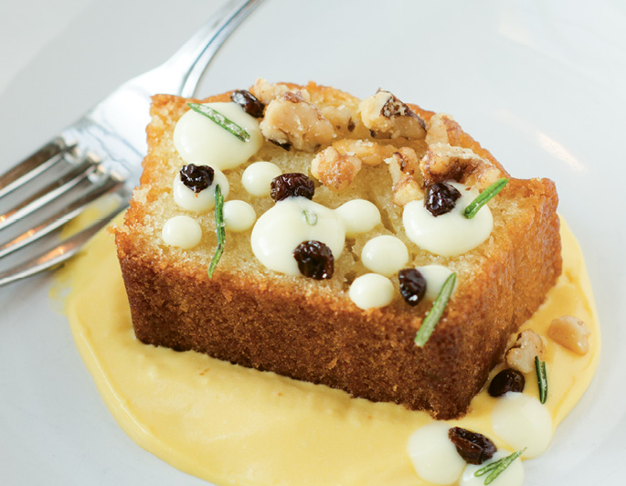 Light & Bright: Toscano's olive oil cake blends the best of savory, salty, and sweet with garnishes of pickled currants, candied rosemary, and olive-oil pudding.