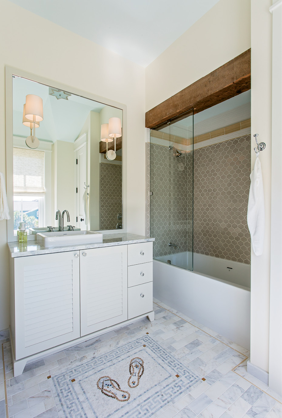 It's In the Details: A vintage wood beam and a tile floor embellished with a custom flip-flop mosaic add personality to this bath.