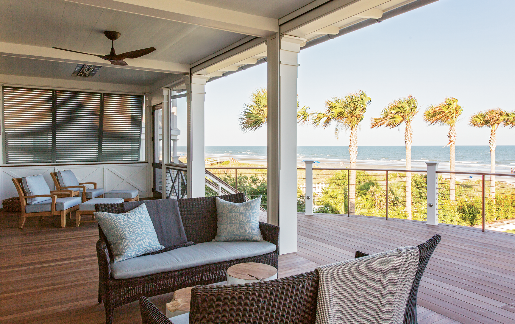 Kingsley Bate furnishings make this second-floor oceanfront patio feel like an extension of the family room.