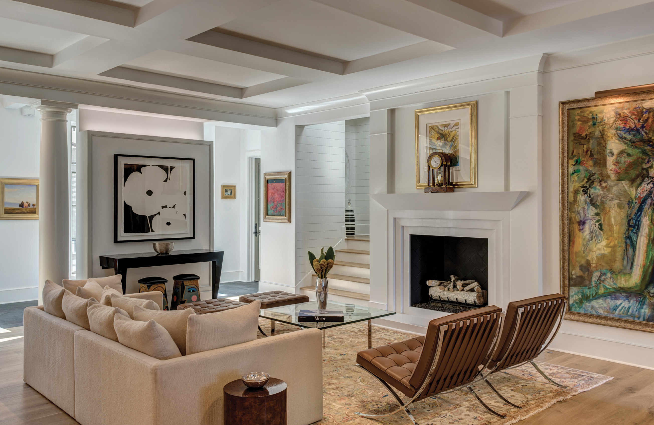 ART ABOUNDS: Years of global travel and a stint living abroad have boosted the couple's art and rug collections. A soothing neutral palette allows the art, including that of Charlestonbased artists Jonathan Green, Robert Lange, and Mickey Williams, as well as works by Chagall, Matisse, Miro, and Picasso, among others, to take center stage.