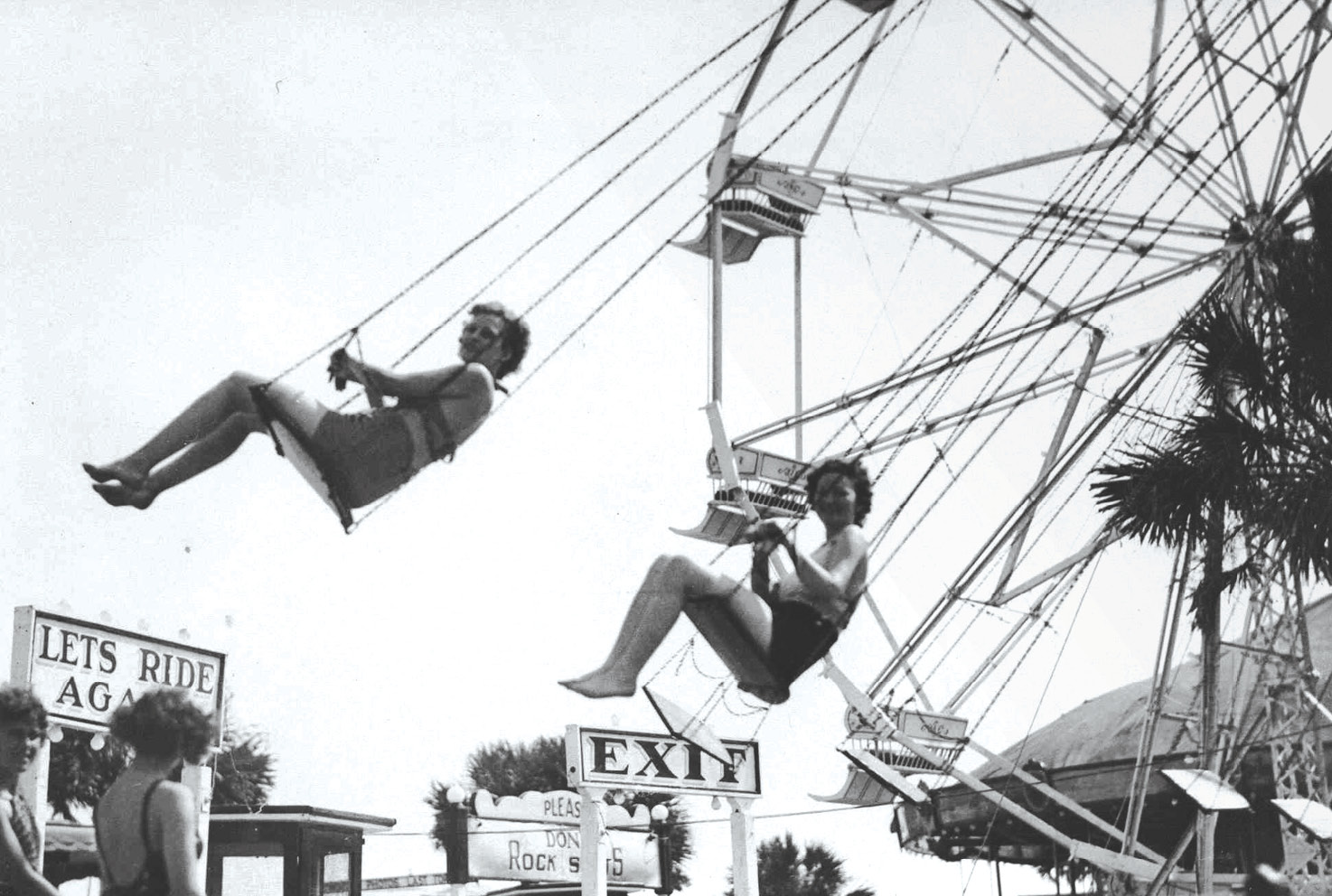 The swing ride at the amusement park in the 1960s