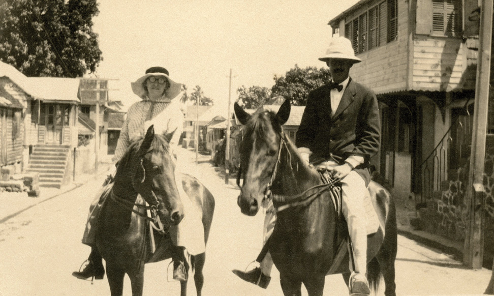Taylor riding with Beebe, possibly in Bartica (date unknown)