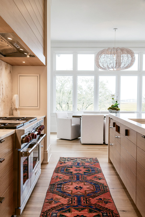Quartz countertops and a stone-topped Restoration Hardware table make for no-sweat cooking and eating surfaces.