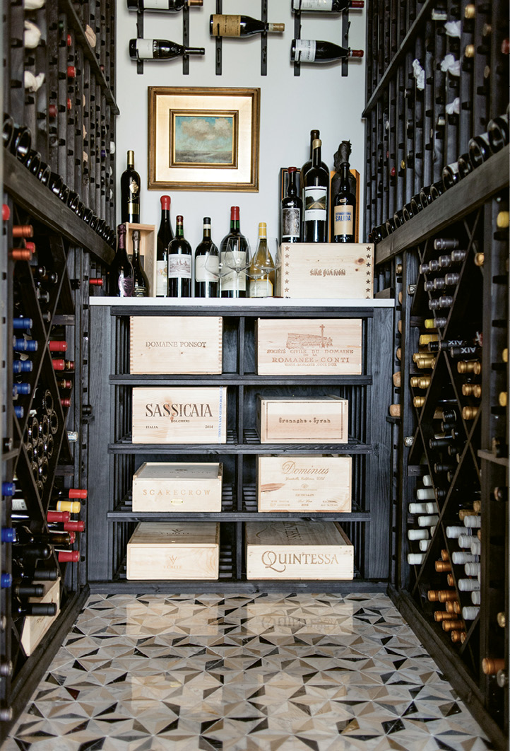 A walk-in wine cellar located off the foyer houses vintages collected during the family's global travels.