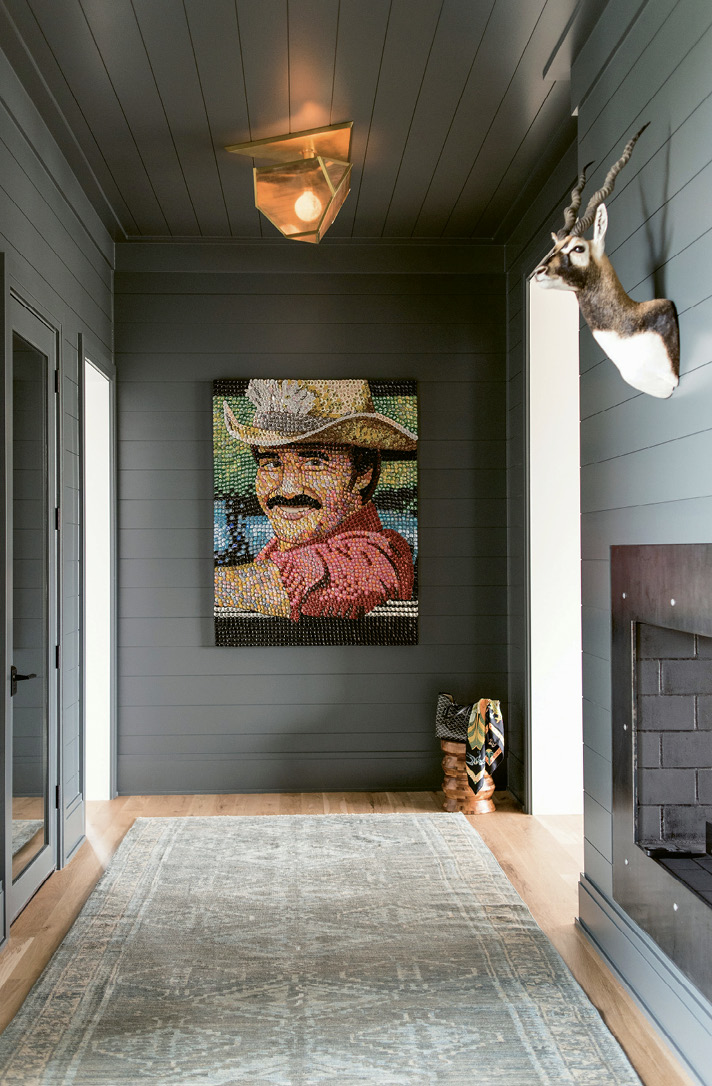 "Farrow & Ball's ""Down Pipe"" covers shiplap in the foyer with its Smokey and the Bandit bottle-cap painting"
