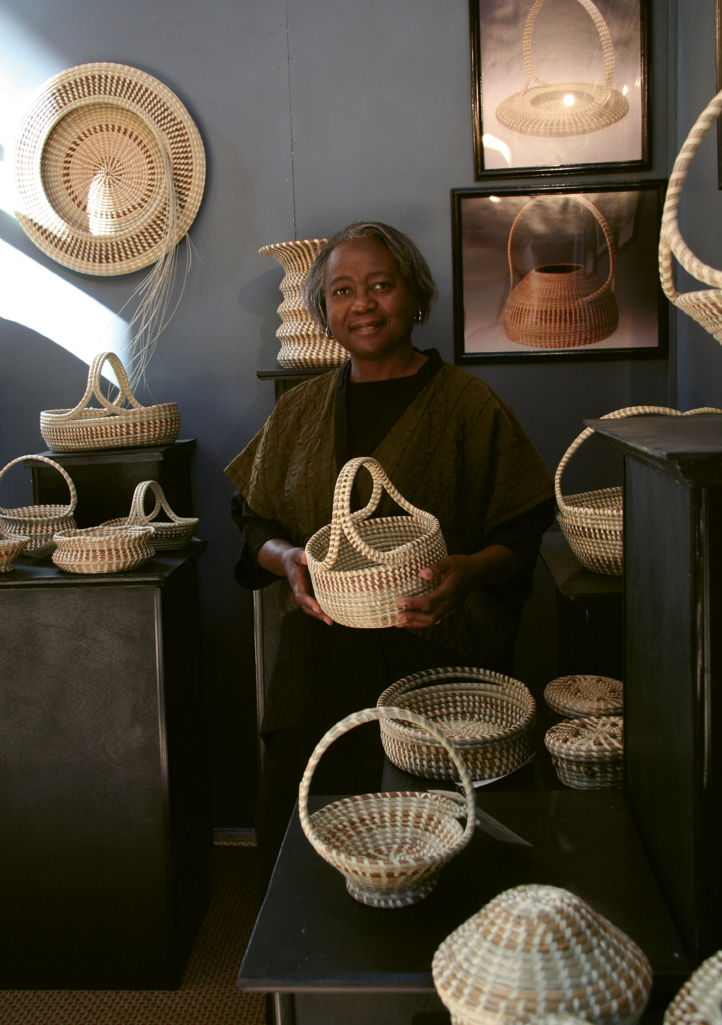 Artful Precision: Jackson's baskets are true to traditional forms, but she weaves innovative artistry into their execution. Meticulous with her choice of materials and precise in her stitches, Jackson's work demonstrates restraint and discipline, with hints of whimsy. Jackson is pictured here at the Smithsonian Craft Show in 2006.