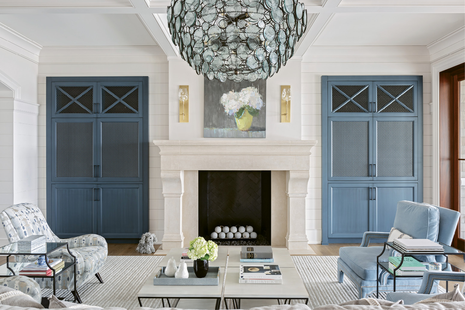 Hundreds of glass circles in the Currey and Company chandelier play with the ever-shifting light outside. A large oil painting by Barbara Flowers highlights the living room. The striking work of white hydrangeas captivated Suzie the moment she saw it in the window of Principle Gallery in Charleston.