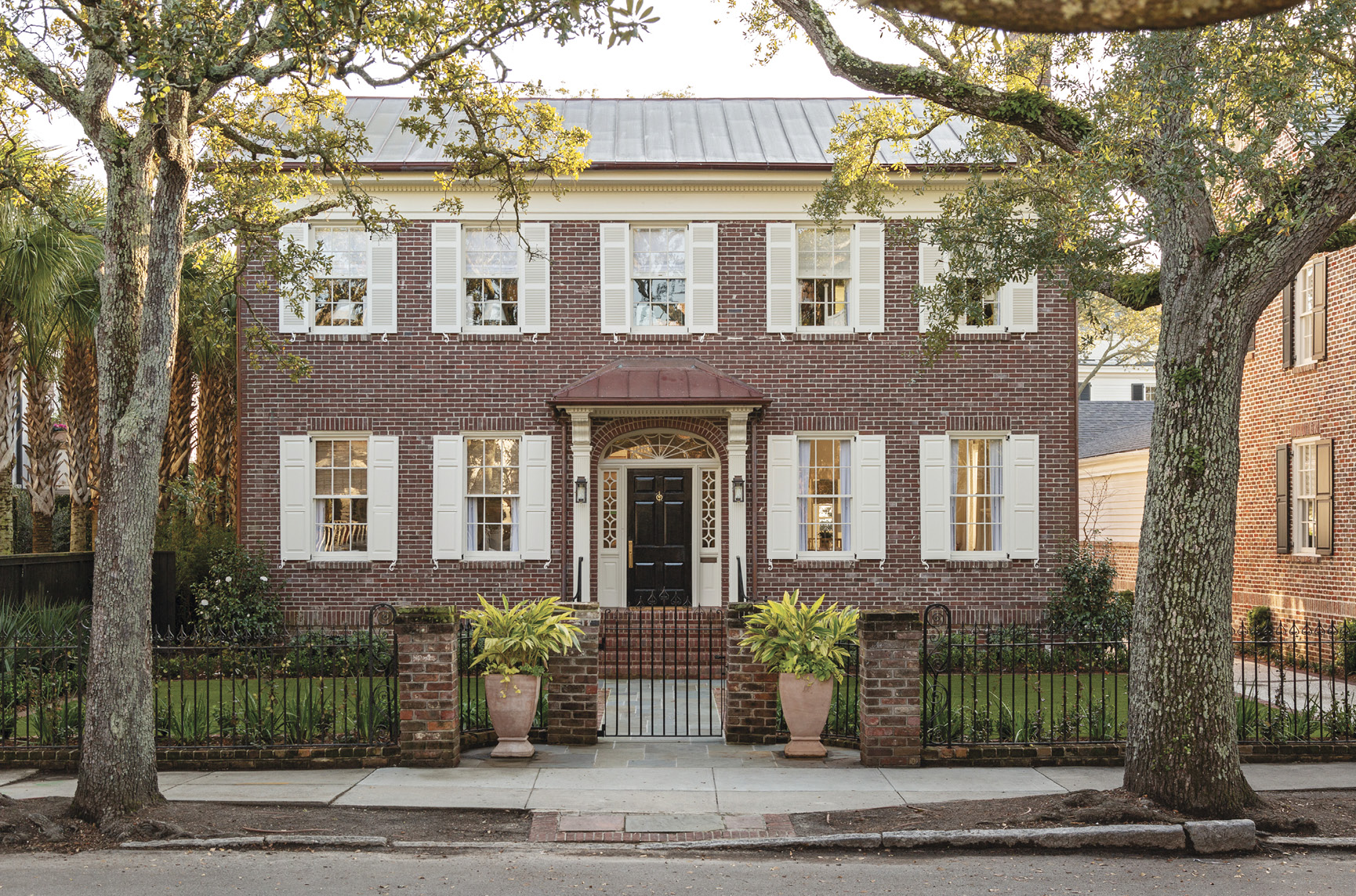 """HIP TO BE SQUARE: Working with an architect, a builder, and an interior designer, Cate and Hugh Leatherman updated a boxy brick Colonial-style house South of Broad to suit their brood.   """"I love how neighborhoody it feels here,"""" says Cate, who grew up around the corner. """"It has a family vibe."""""""
