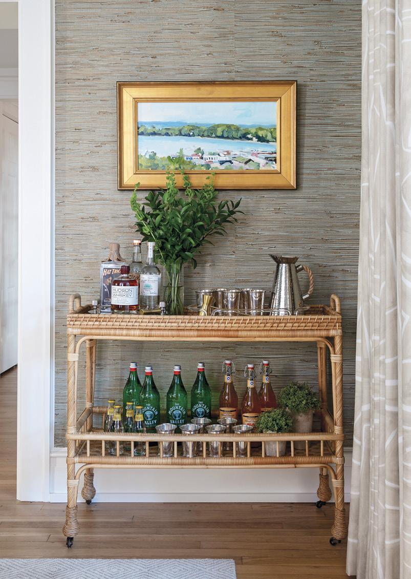 A Serena & Lily bar cart anchors a painting by Michigan artist Richard Kooyman.
