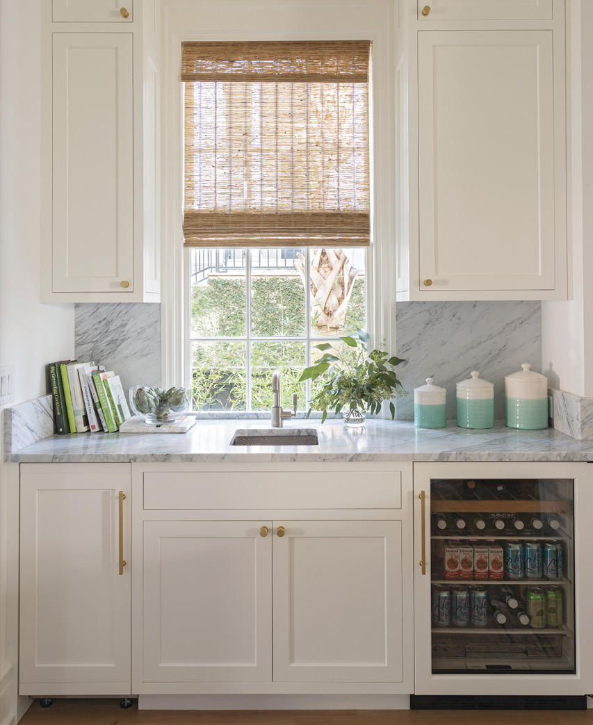 Cabinets by Hostetler Custom Cabinetry with Carrara marble tops continue the bright, light theme