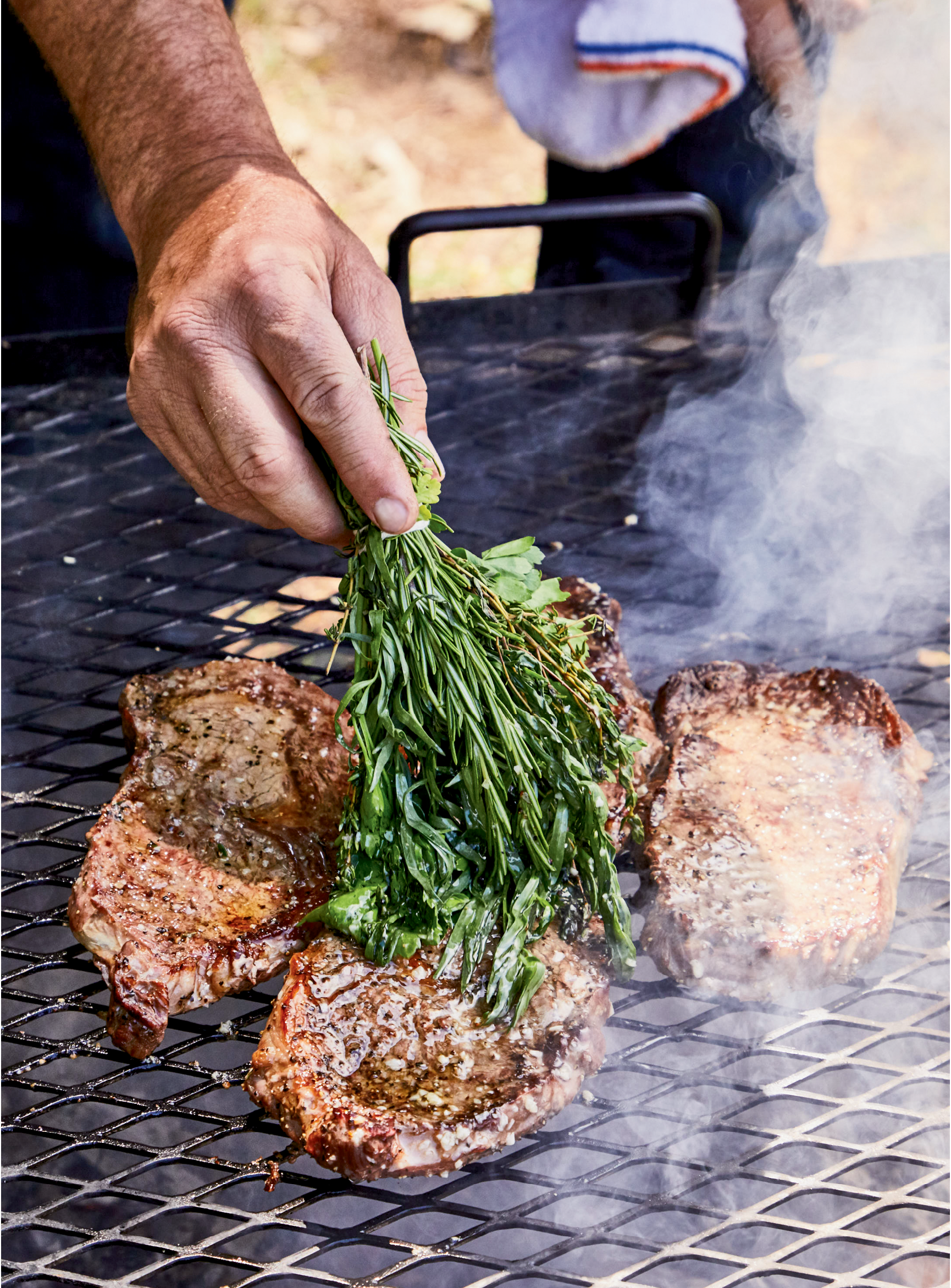 Wood-Grilled Rib Eyes with Herb Brush