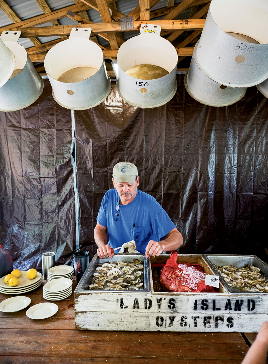Frank Roberts, founder of Lady's Island Oysters, with some of his catch on ice