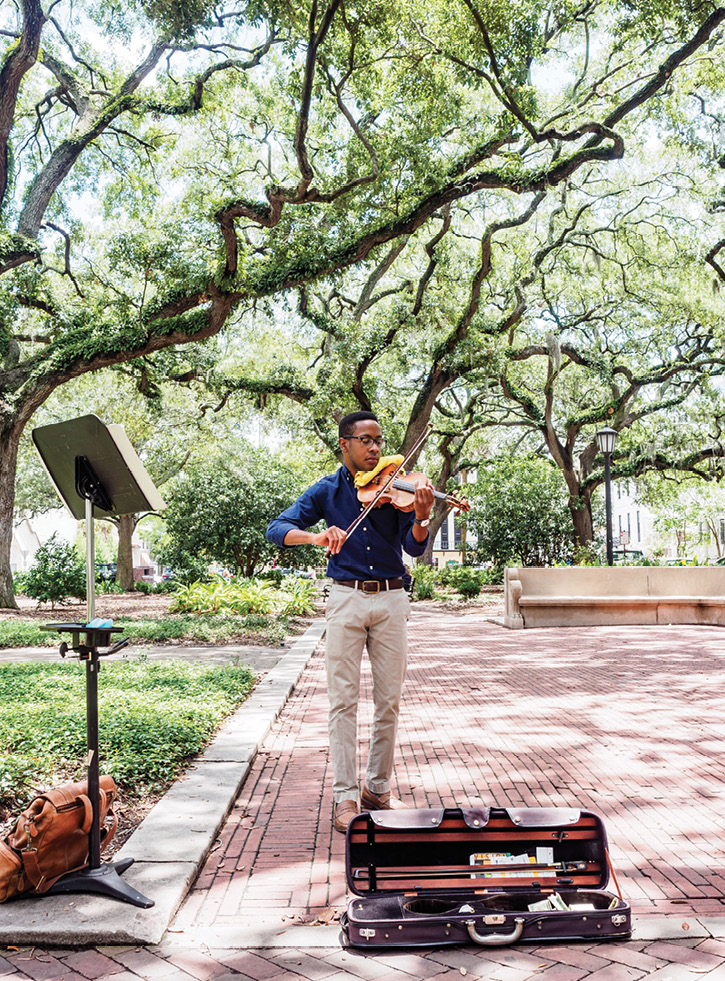 "Violinist Michael Houston of Beaufort says he prefers playing in Savannah squares because ""people are more relaxed"" and listen awhile."