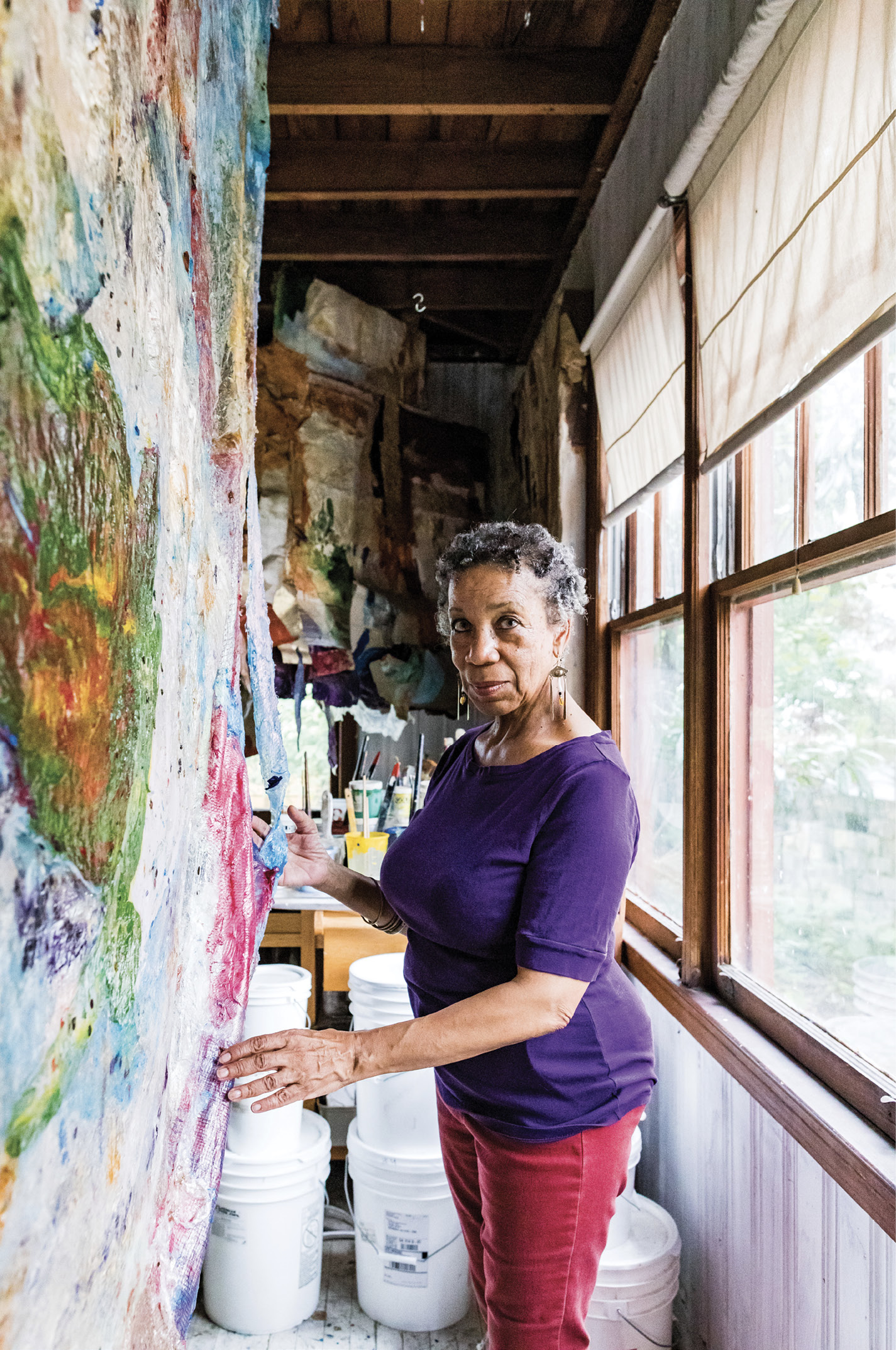 "Artist Suzanne Jackson in her home studio in the Starland District; a retrospective of her work titled ""Five Decades"" was featured last year at the Telfair Museum's Jepson Center. Her recent paintings are sculptural layers of acrylic—no canvas, no frame."
