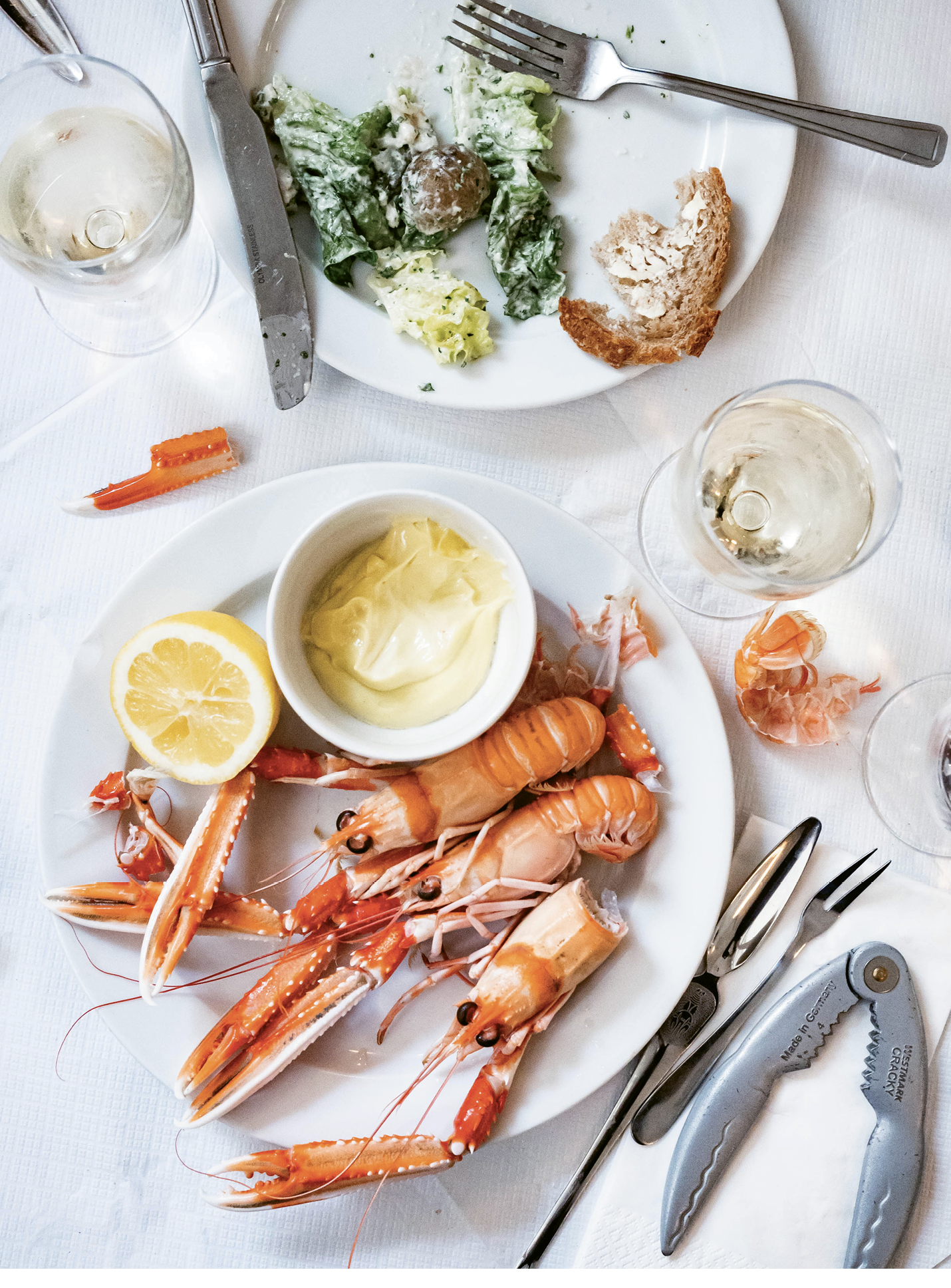 The day's menu included chilled langoustines with lemon and aioli, lobster-like and salty-bright, with glasses of Petit Salé de Villeneuve, 2017.