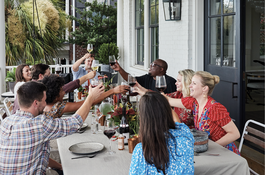 The party toasts to Red Clay's continued success and an artfully crafted meal.