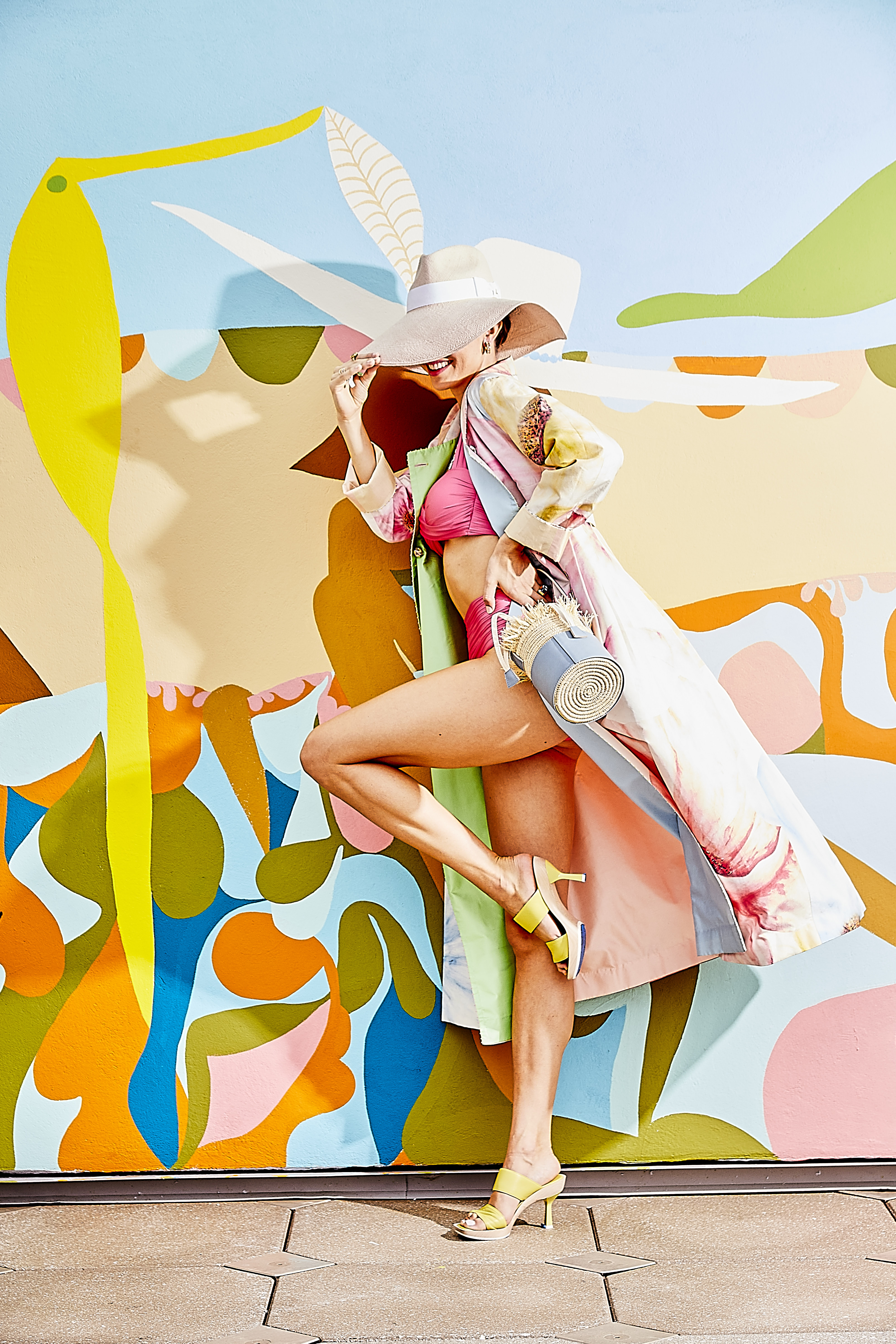 """Bikini Society: Perf reversible coat, $1,950 at RTW; twist-front bandeau, $94, and high-waist bottom, $74, both at Tara Grinna; Lafayette 148 NY """"Icon"""" hat, $398, Chloe sunglasses, $315, and A.G.L. """"Surin"""" heel, $560, all at Gwynn's of Mount Pleasant; Demarson """"Eden"""" cuff earrings, $195 at Showroom at Freshfields Village; David Yurman drop pendant necklace, $2,300, and """"Novella"""" statement ring, $5,500, at REEDS Jewelers in Mount Pleasant Towne Centre; Hearts on Fire with Hayley Paige """"Bring the DRAMA"""" diamond band, $6,950 at Sandler's Diamonds & Time; Christopher Designs 18K gold ring with lemon quartz and diamond accents, $3,940 at Diamonds Direct; and """"The Maroc Collection"""" fringe bucket bag, $228 at Beau & Ro"""