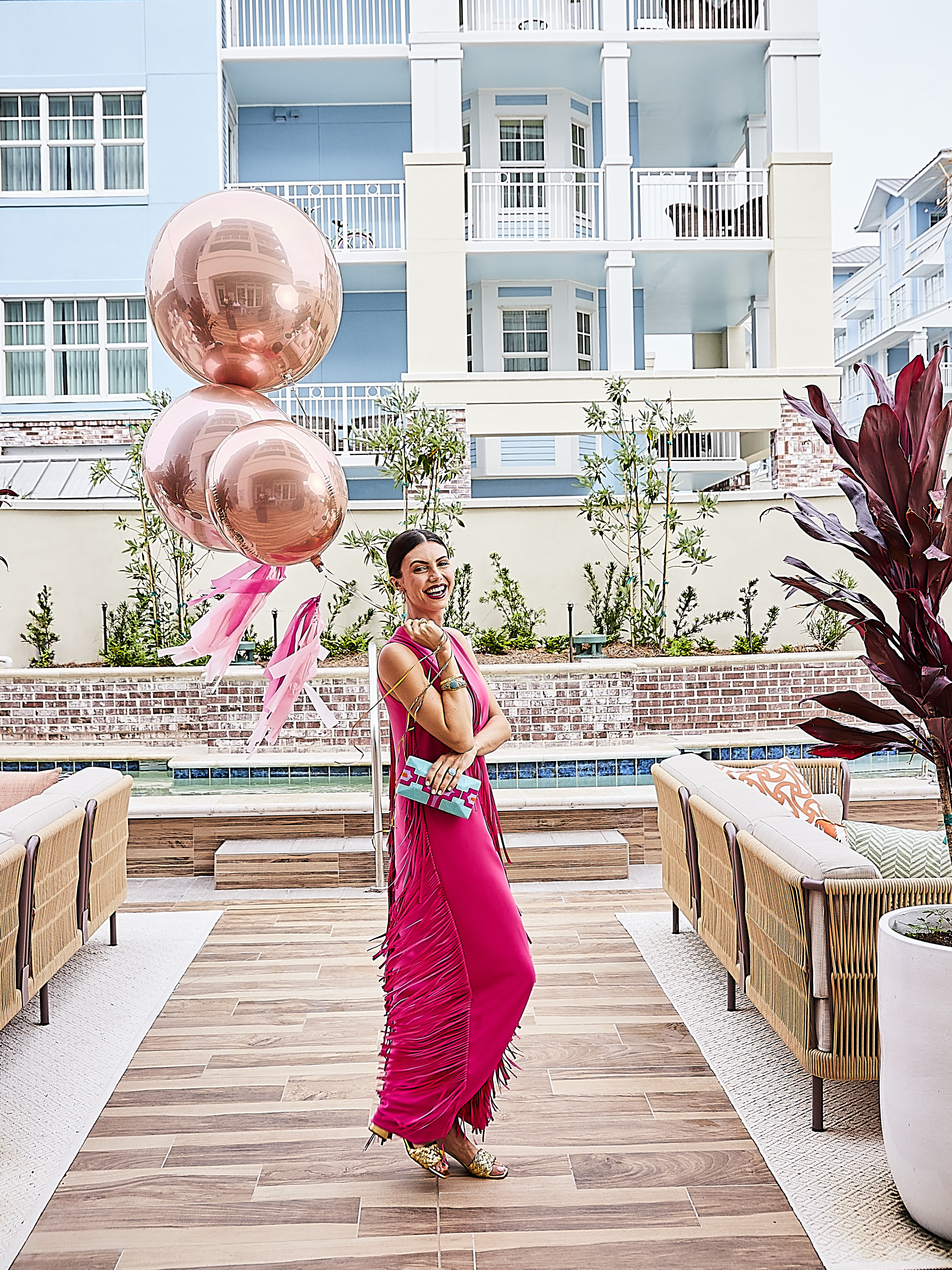 """Haute Pink: Catherine Regehr fringe gown, $1,970 at Gwynn's of Mount Pleasant; Demarson """"Luna"""" pearl earrings, $285 at Showroom; Roberto Coin 18K slim bangle with fleur-de-lis diamonds, $6,500 at M.P. Demetre Jewelers; Estate Collection gold bangle, $4,025, and JudeFrances """"Moroccan Marrakesh"""" turquoise ring, $2,200, both at Croghan's Jewel Box; old European diamond ring, $9,895 at Sandler's Diamonds & Time; Beatriz clutch, $260 at Shoes on King; Marc Fisher """"Nahea"""" block-heel sandal, $150 at Rhodes Boutique; balloons courtesy of BoomBalloon Charleston"""