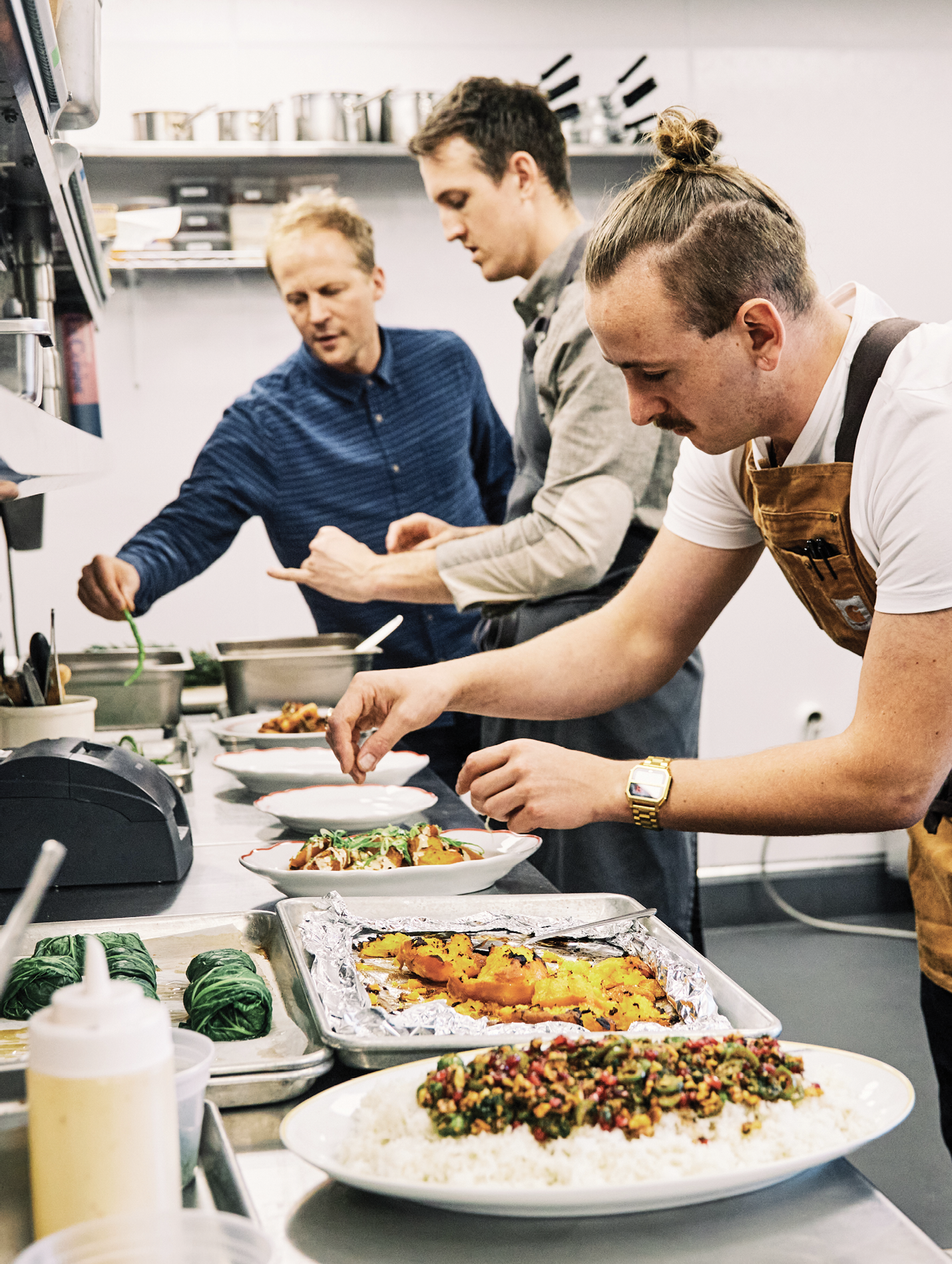 The chefs at Basic Kitchen (Charles Layton, right) and Post House (Evan Gaudreau, center) have their own culinary styles, yet both are aligned with Ben's focus on elevating fresh, wholesome ingredients.