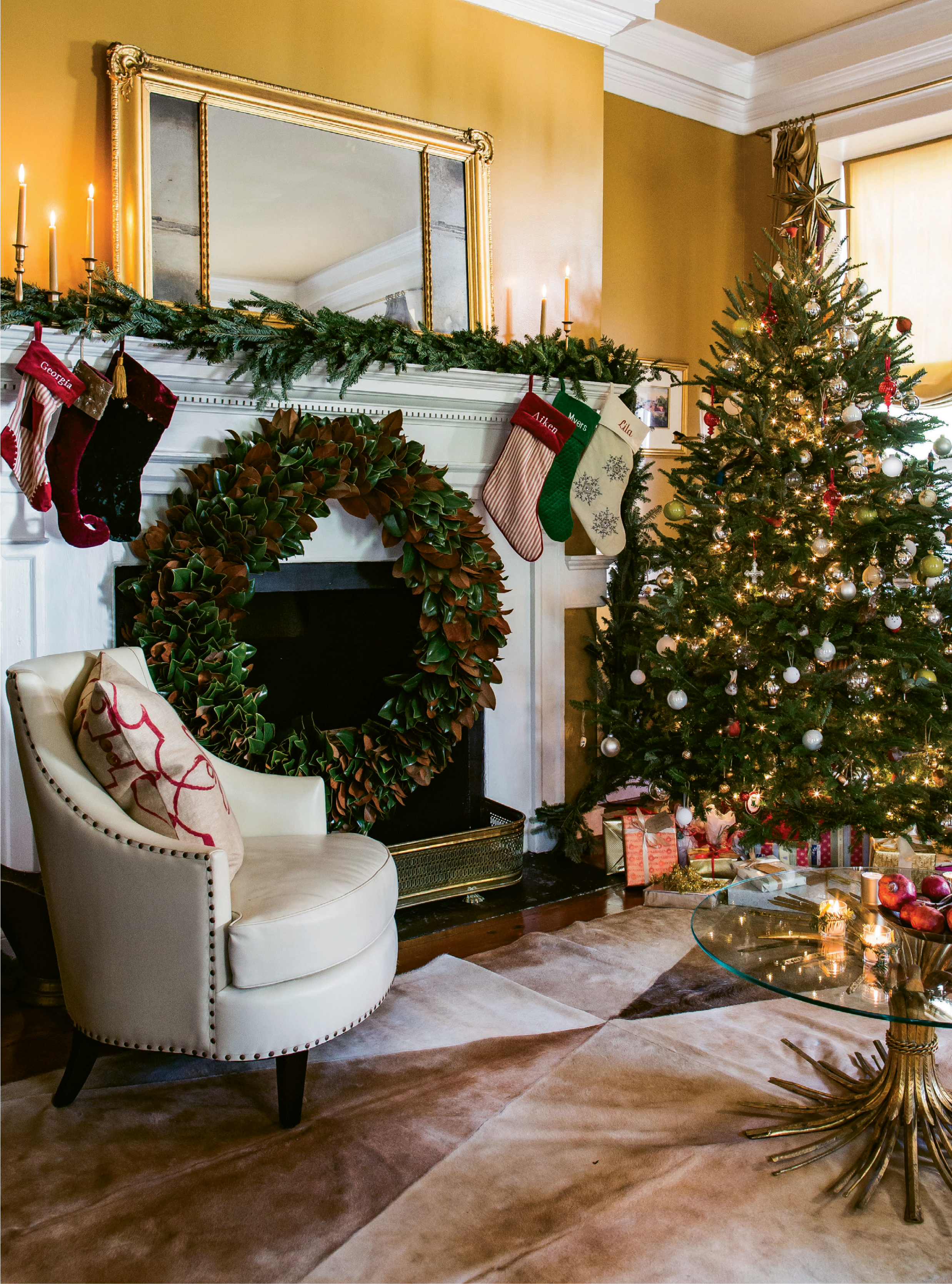 "LIGHT IT UP: A Christmas tree with lights and presents more than suffices for décor this time of year, says Tara. She added simple metallic balls and her children's homemade ornaments to the mix. TIP: Tara's go-to for ""thick, gorgeous foil wrapping paper"" is T.J. Maxx."