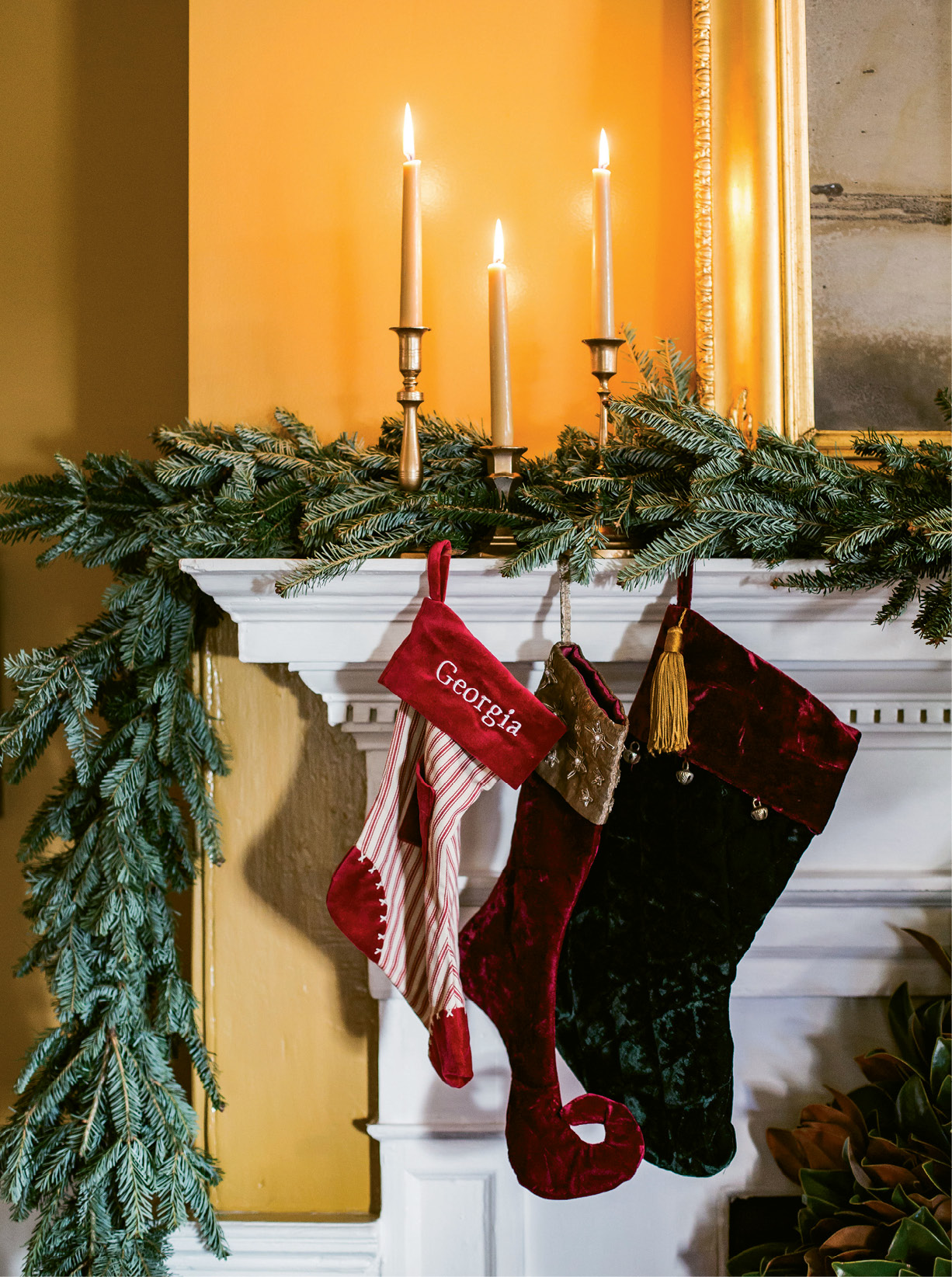 "HANG WITH CARE: Simply weaving garlands amid mantel decorations works for Tara, as does lighting candles. ""Just don't burn scented candles around food,"" she says."