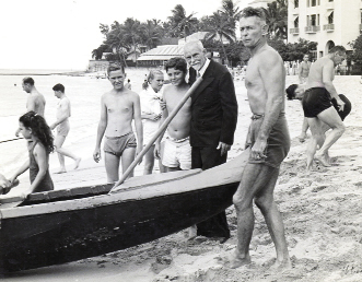 NATIVE TALENT Charleston's own Alexander Hume Ford (pictured here in a suit at Waikiki's Outrigger Canoe Club, which he founded in 1908) saved the sport of surfing from oblivion.