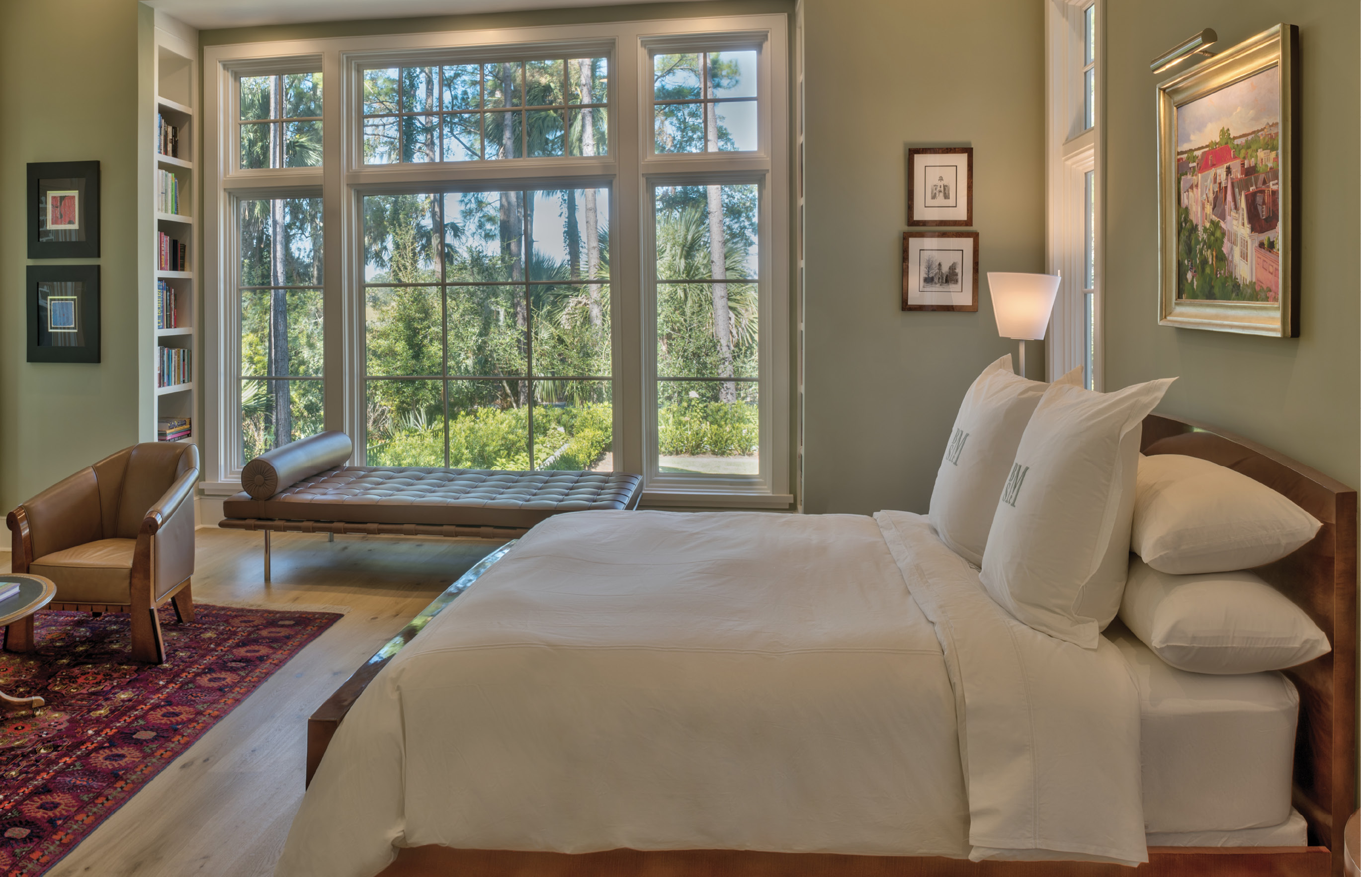 """TRANQUIL RETREAT: Walls throughout the home are white, except for the soothing seafoam green in the master suite. With windows on three sides, the master gets plenty of soft light; """"the beauty when the sun is coming up is very special,"""" the wife says."""