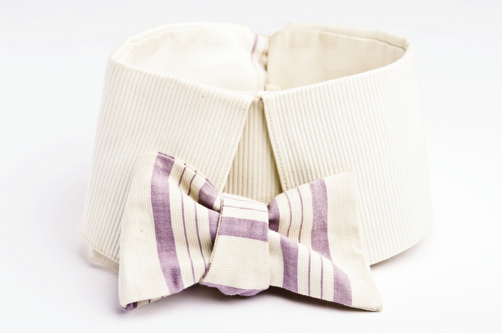 "HIGH COTTONThese early 20th-century cotton ties came with collars. The purple one bears the stamp: ""The Corsair. / Patent Feb. 18, 1900"" and has a buttonhole for attaching to the shirt. A slit on one side allows the tie to wrap around the neck, making it adjustable."