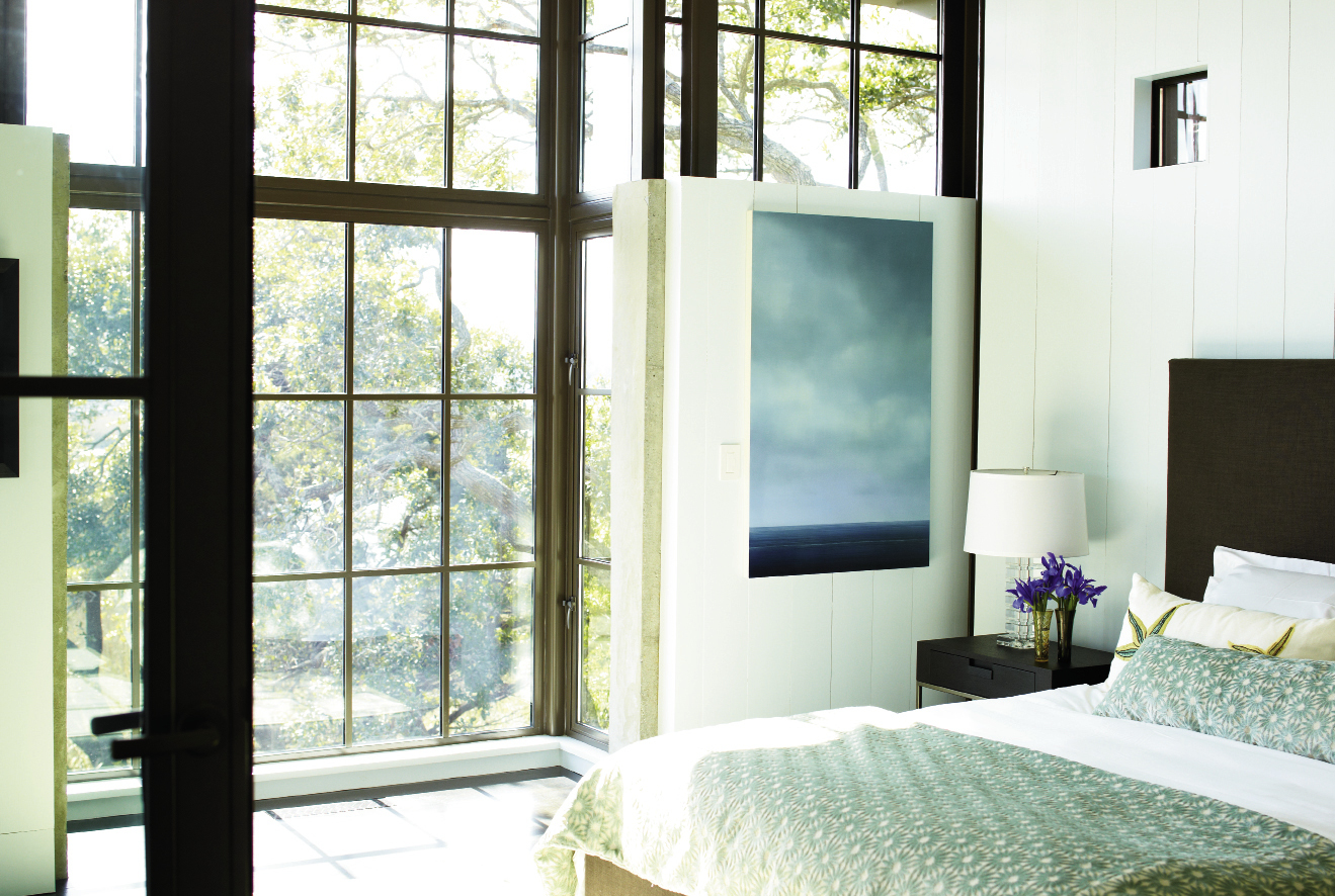 Dream State: Light from the marsh streams into the master bedroom, outfitted with a B&B Italia/Maxalto bed,  bedding from GDC, and a painting by Vermont artist Peter Brooke.