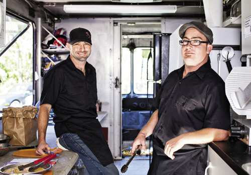 Jonathan Colarusso (left) and brother Brian work inside the Strada Cucina truck
