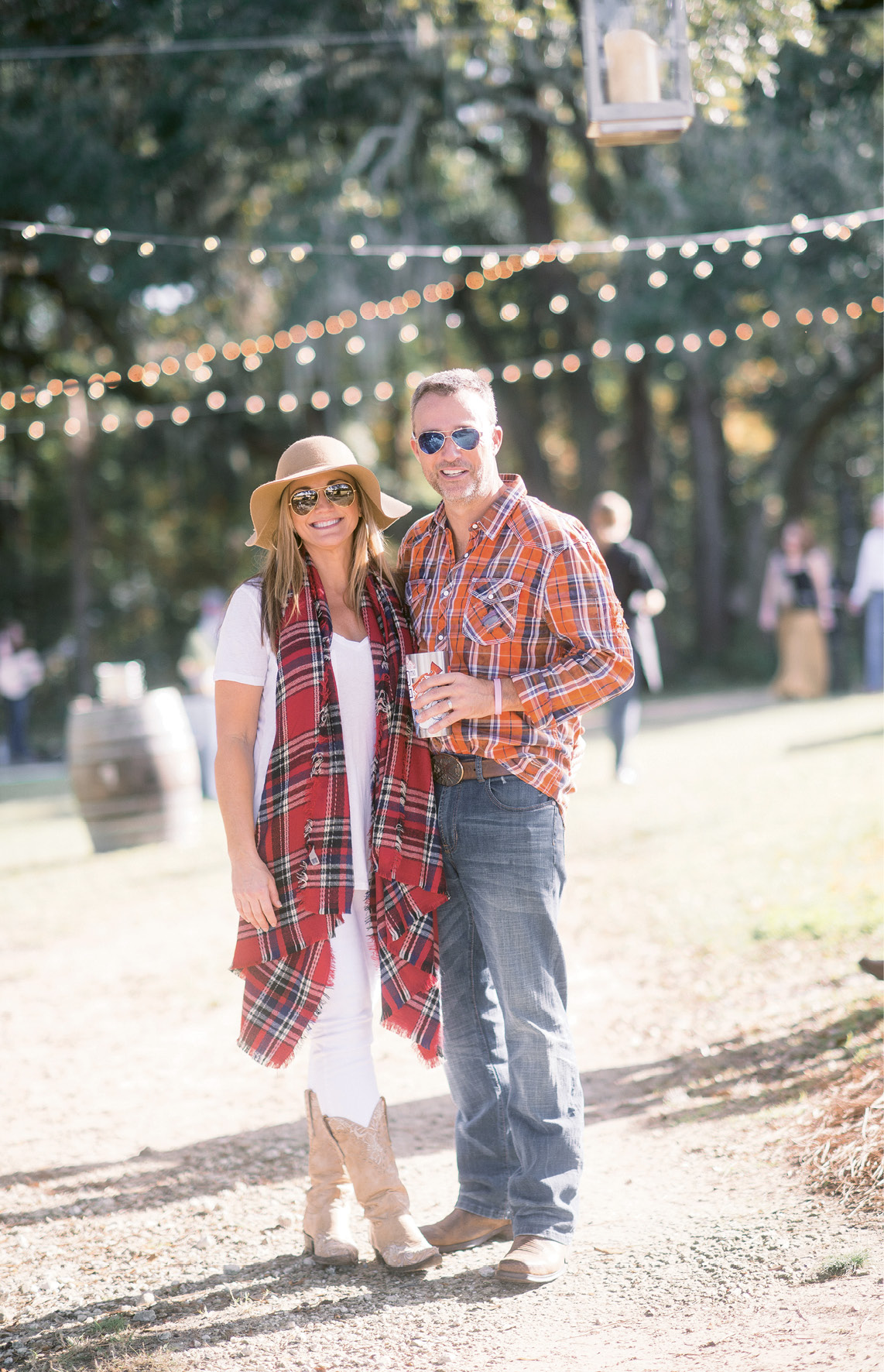 "A Relaxed Celebration: Melissa and Kevin Williams asked family and pals to pull out their cowboy boots to celebrate their wedding at a dressed-down winter fête on Yonges Island. ""Kevin and I often have oyster roasts—sometimes for just the two of us in our backyard,"" she notes."