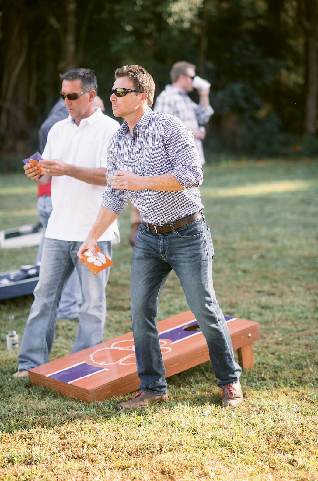 Game On: Partygoers played corn hole on the couple's personal (and school-spirited) boards.