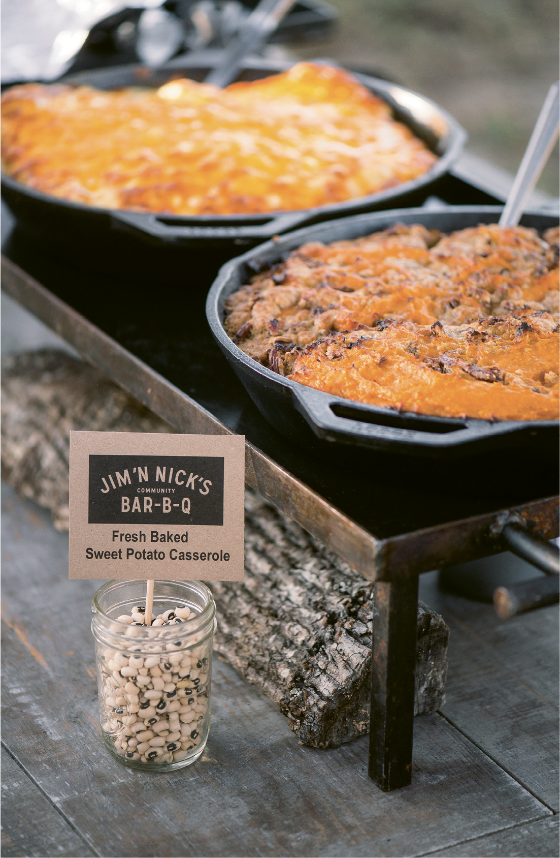 The cast-iron skillets and black-eyed pea menu markers on the buffet table fit right in with the event's down-home vibe.