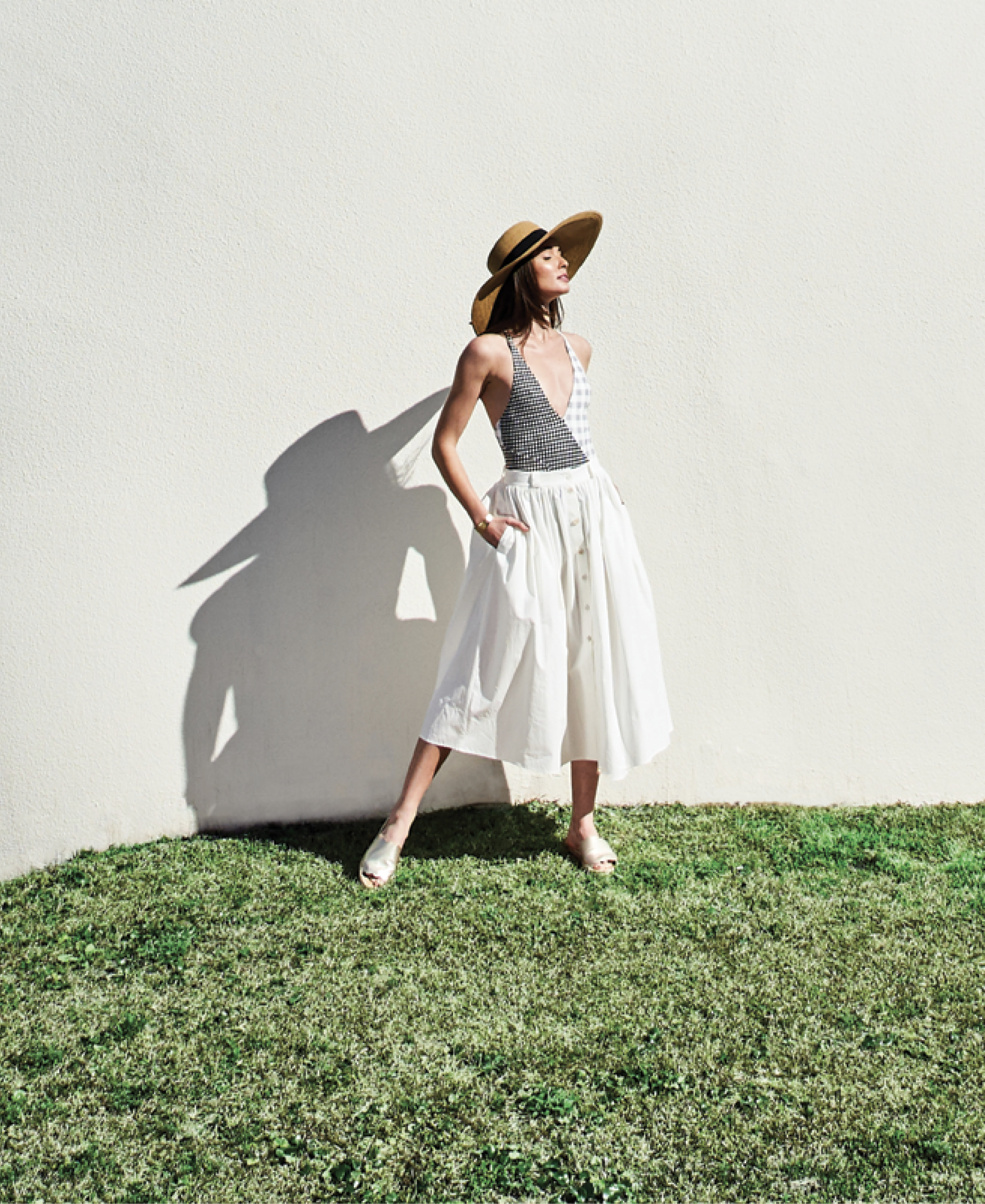 """SUIT UP - Marysia """"Suffolk Maillot,"""" $359 at Everything ButWater; Brock Collection cotton """"Olivo"""" button-up skirt, price upon request at RTW; Gretchen Scott sun hat, $59 at Gretchen Scott; Kendra Scott """"Tenley"""" 14K gold-plate cuff, $95 at Kendra Scott; Sam Edelman """"Andy"""" leather slide in """"light gold,"""" $90 at Shoes on King"""