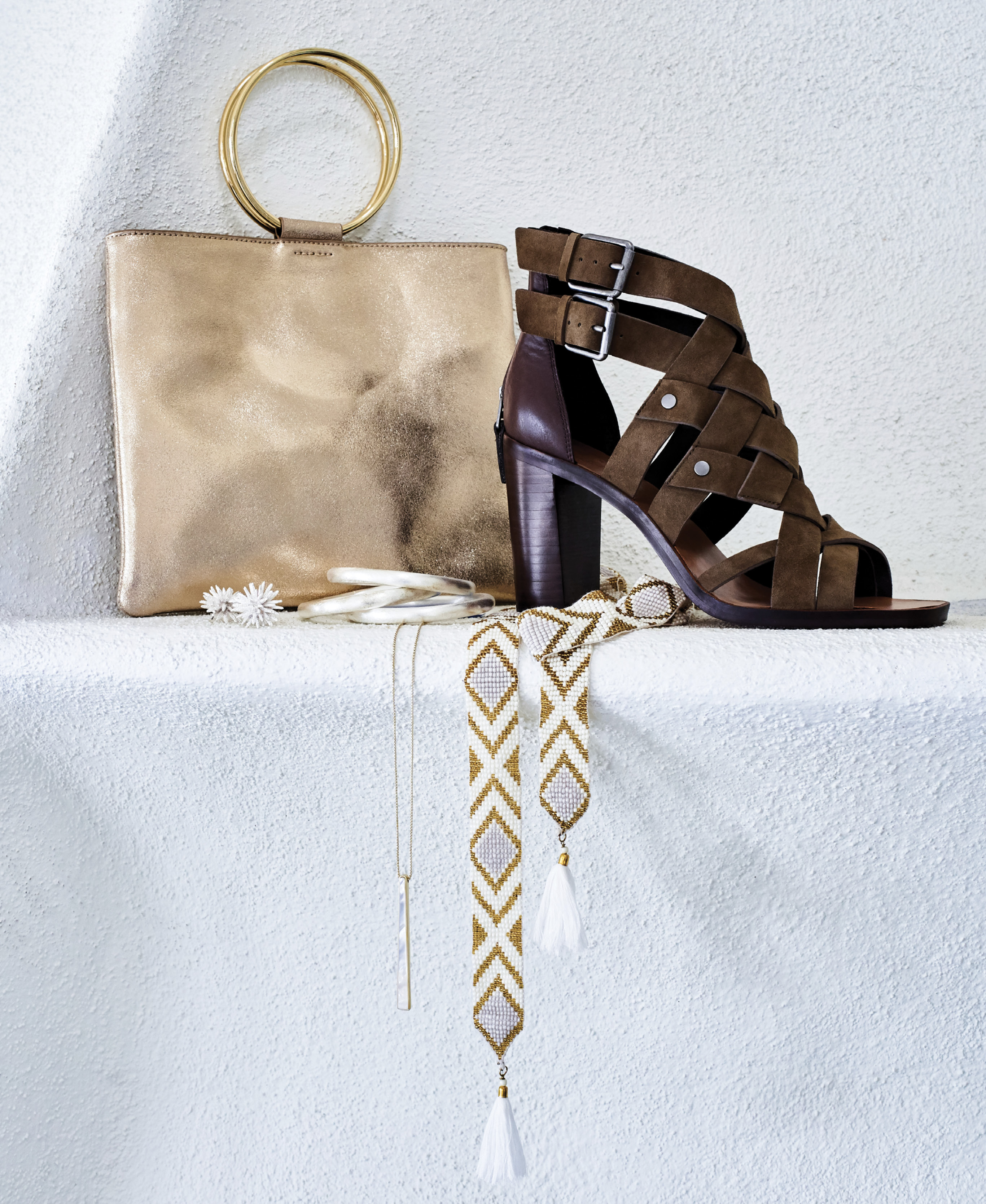 "FINISHING TOUCHES - Thacker ""Le Pouch"" bag in ""gold,"" $148 at Maris DeHart; Dolce Vita ""Noree"" suede heels in ""olive green,"" $170 at Shoes on King; Gretchen Scott woven beaded belt, $55 at Gretchen Scott; Betty Carre brushed silver bangles, $126 for set of 3 at Out of Hand; Kendra Scott ""Baleigh"" pendant necklace in ""ivory mother of pearl,"" $95 at Kendra Scott; Karine Sultan ""Fiji Reef"" stud earrings, $48 at Croghan's Jewel Box"