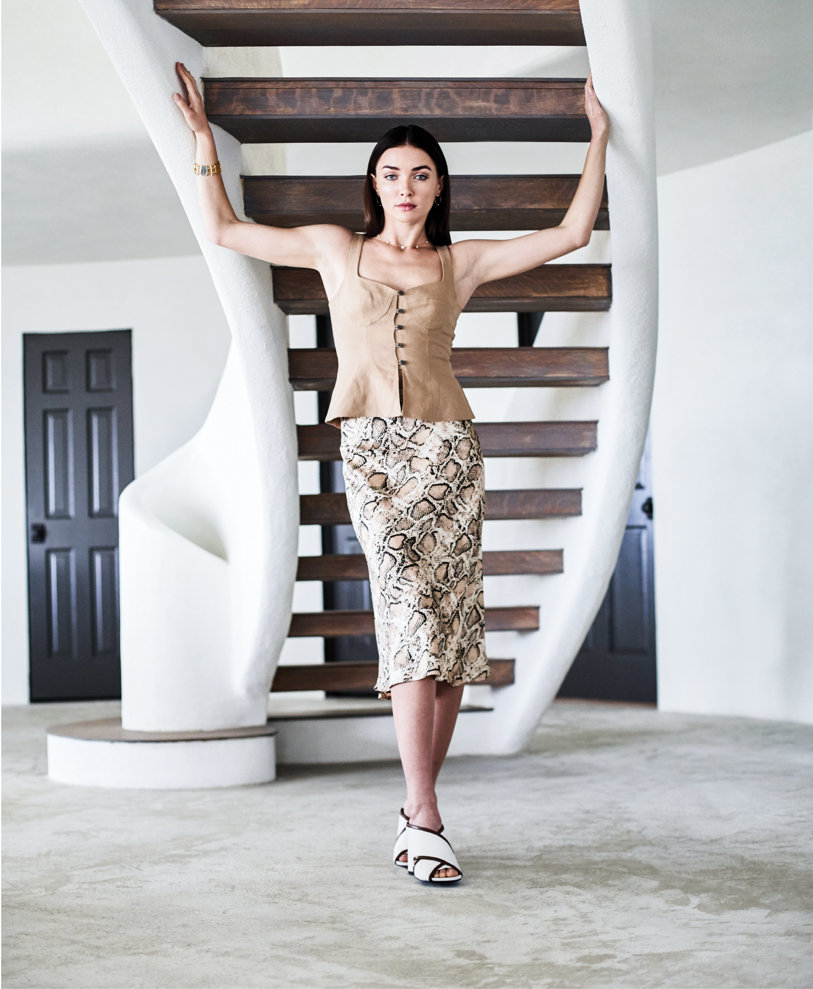 """NATURAL SELECTION - Mara Hoffman """"Lola"""" top in """"khaki,"""" $325 at Hampden Clothing; Olivaceous """"Kiki"""" snakeskin-print midi skirt, $42 at House of Sage; Stuart Weitzman """"Sam 75"""" crisscross leather slides, $475 at Gwynn's of Mount Pleasant; Elizabeth Locke 19Khammered gold and Venetian glass """"Muse"""" bracelet,$11,950, and 14K gold and diamond earrings, $595, bothat Croghan's Jewel Box; custom 14K goldand diamond necklace with diamond flower clusters, price upon request at Diamonds Direct"""