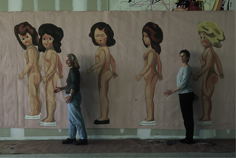 "Big Show: In 2002, Fantuzzo curated ""Larger Than Life: A Second-Story Show,"" an exhibition of large outdoor works she and nine other local artists created and installed on buildings and landmarks around town for Piccolo Spoleto. Artists Kristi Ryba and Mary Walker pose before Ryba's parade of dolls"