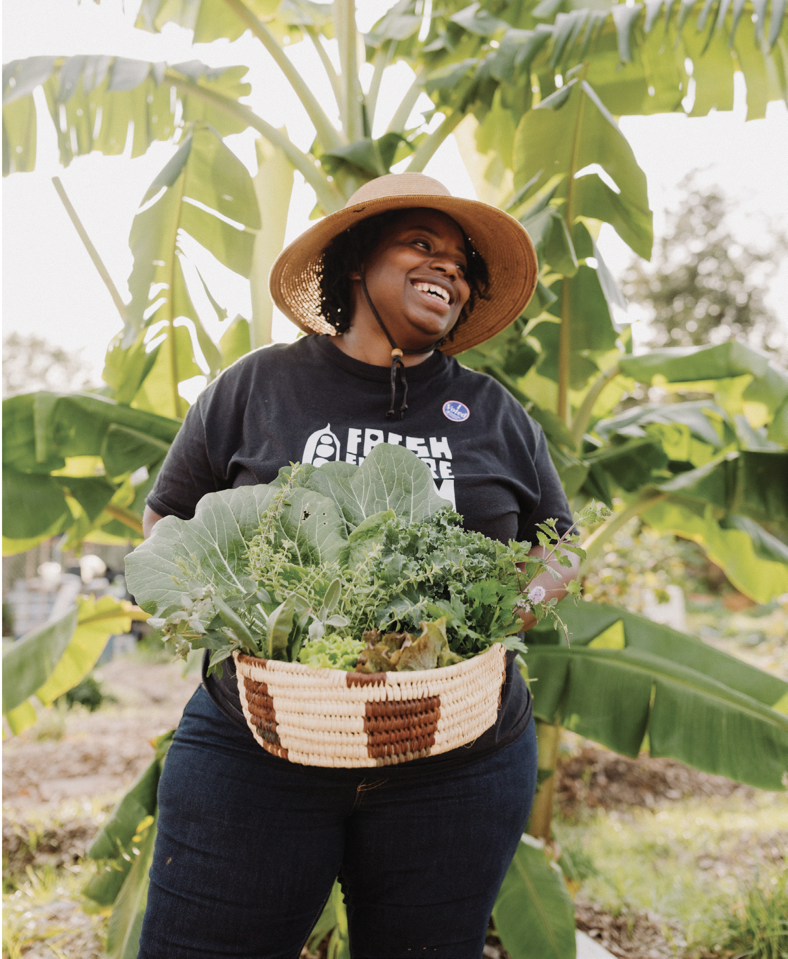 Farmer and community visionary Germaine Jenkins revels in a harvest of healthy greens from her North Charleston nonprofit, Fresh Future Farm.