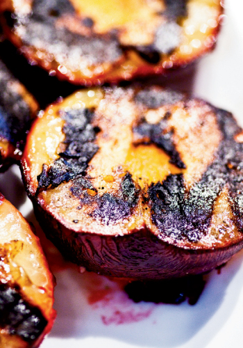 A plum's tendency toward tartness fades when grilled because the process draws out its sugary side.
