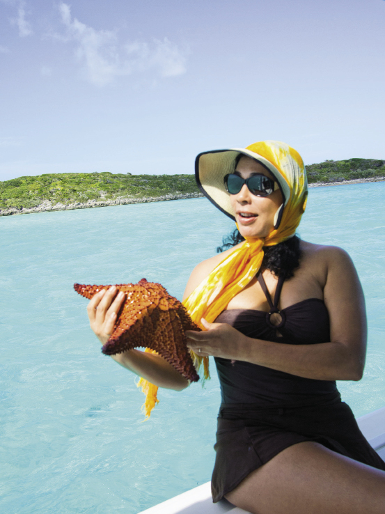 A passenger holds a bony starfish before it's returned to the ocean