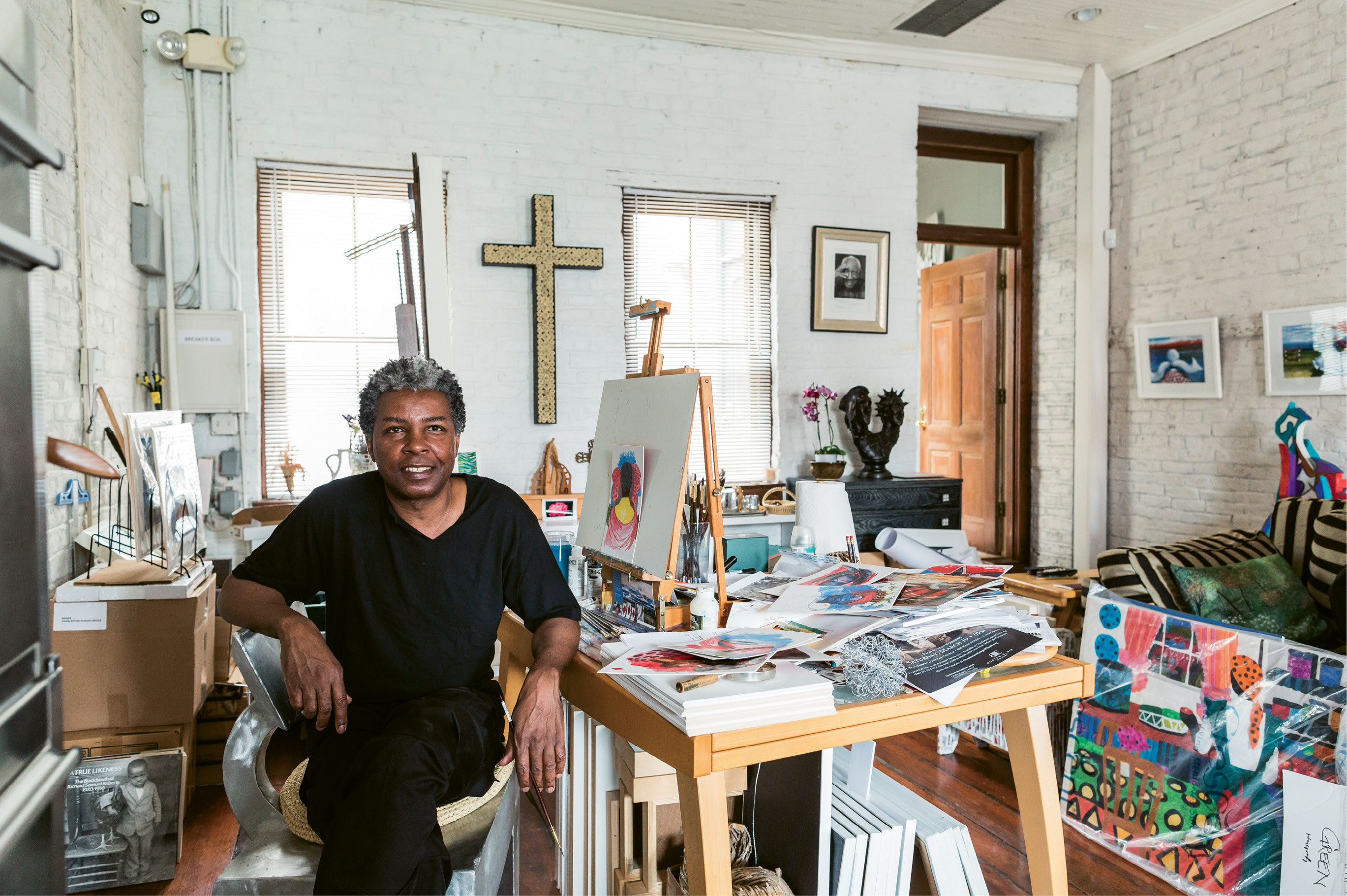 "Green, at work in his downtown studio, is dressed in what he calls his ""uniform"" (always a black T-shirt and pants)."