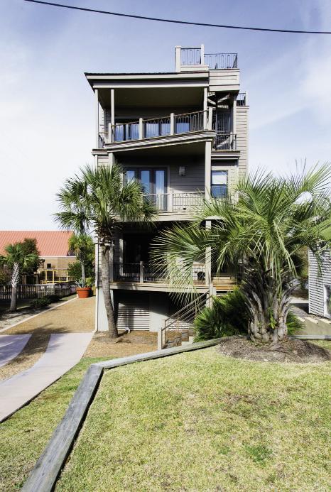 Box Set: Triangular decks offset the three-story home's symmetrical stacked design.