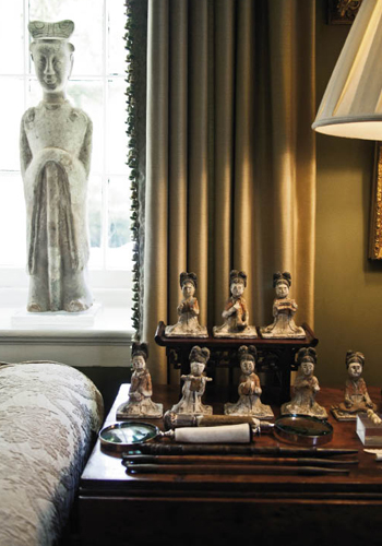 The lushness continues indoors with a bounty of treasures from around the world, including many of Juan's finds—such as the Tang Dynasty musicians and Han Dynasty statue (above left)—from Asia, where he has spent a great deal of time as a travel industry executive.