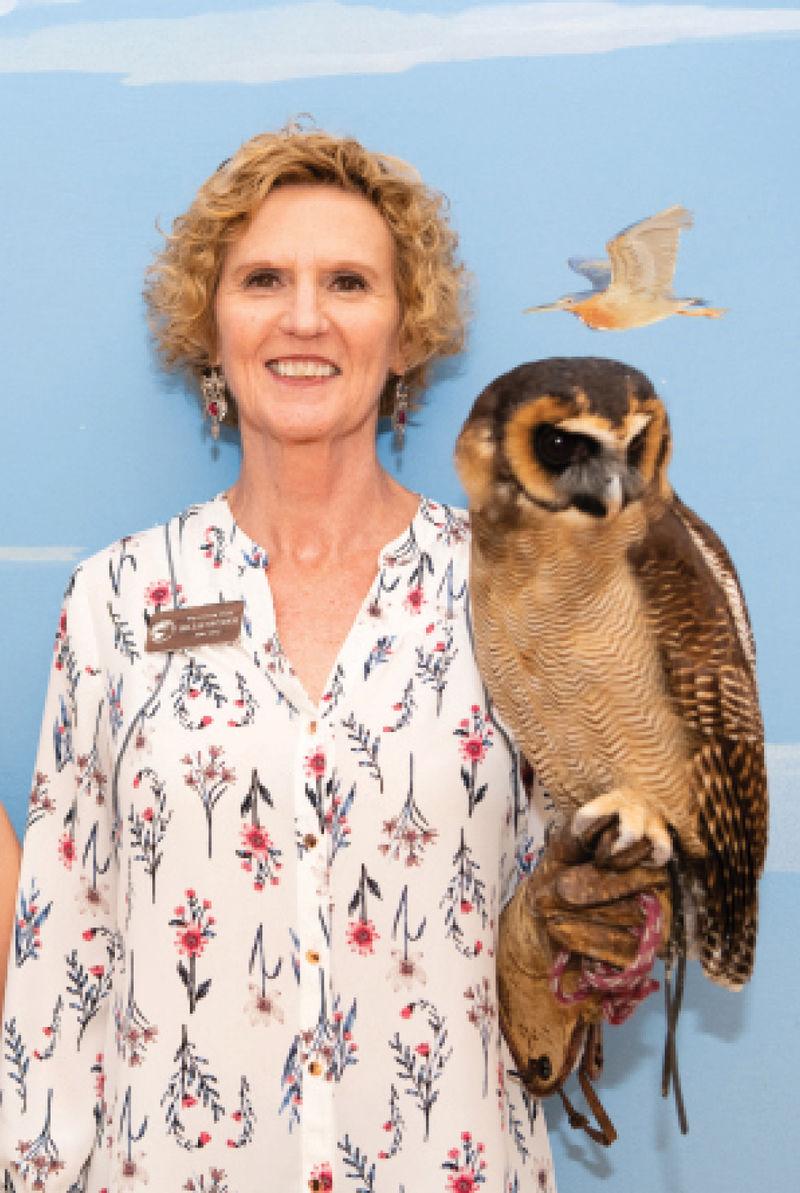 Volunteer staff member Billie Snyder and an Asian brown wood owl