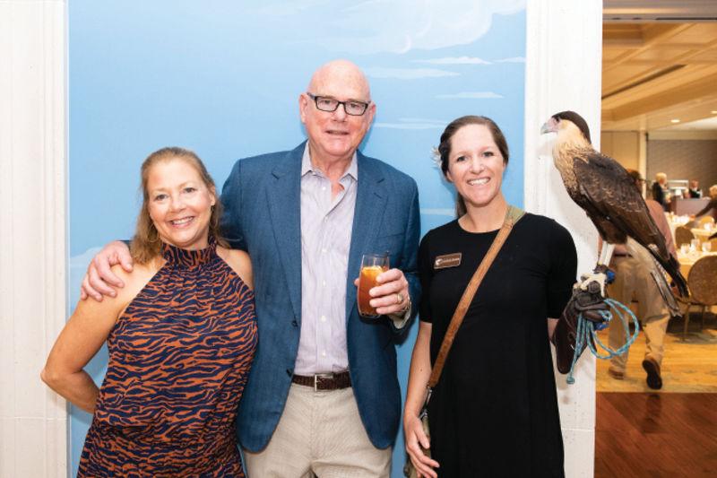 John and Kaye Nance with educator Natalie Hendrickson and a crested caracara