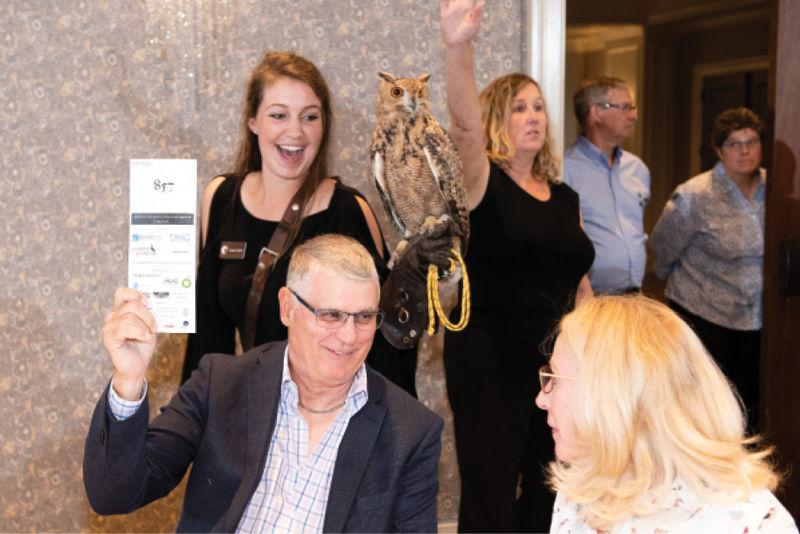 Charles Singleton and Deborah Rickman with educator Jessie Curry and a Savigny's eagle owl